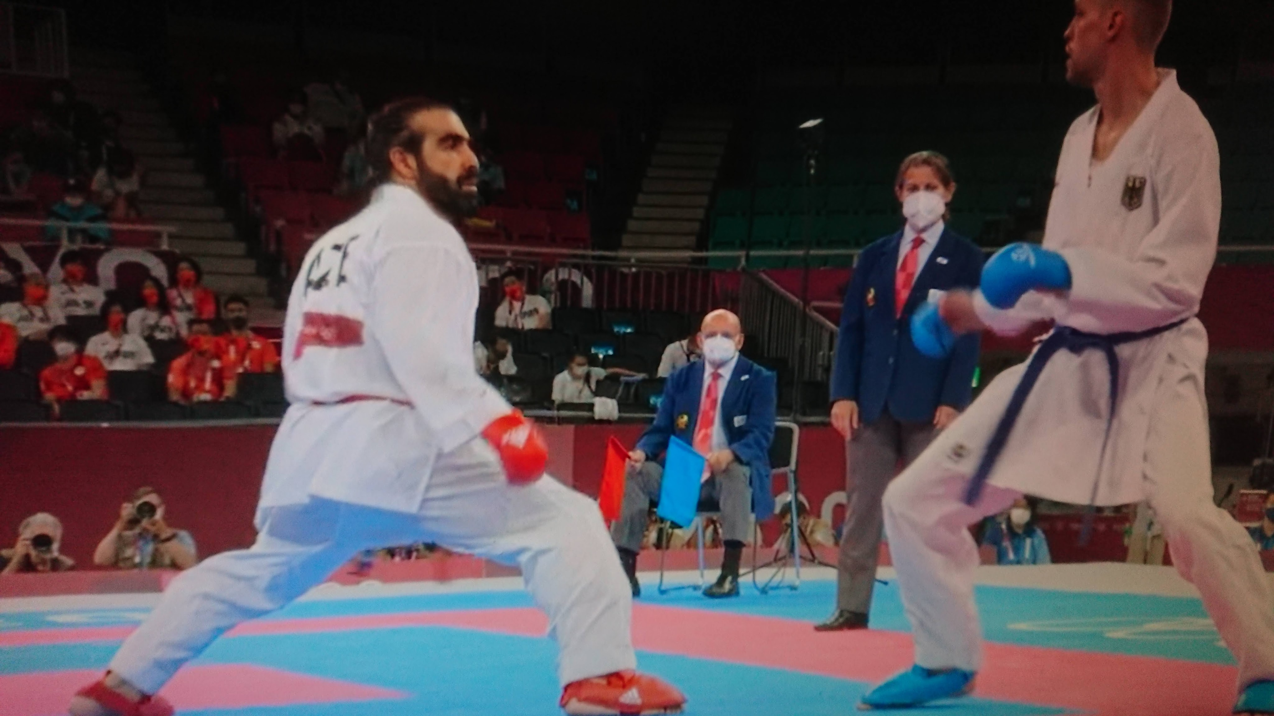 Rafael Aghayev and another competitor sparring in the Tokyo Olympics
