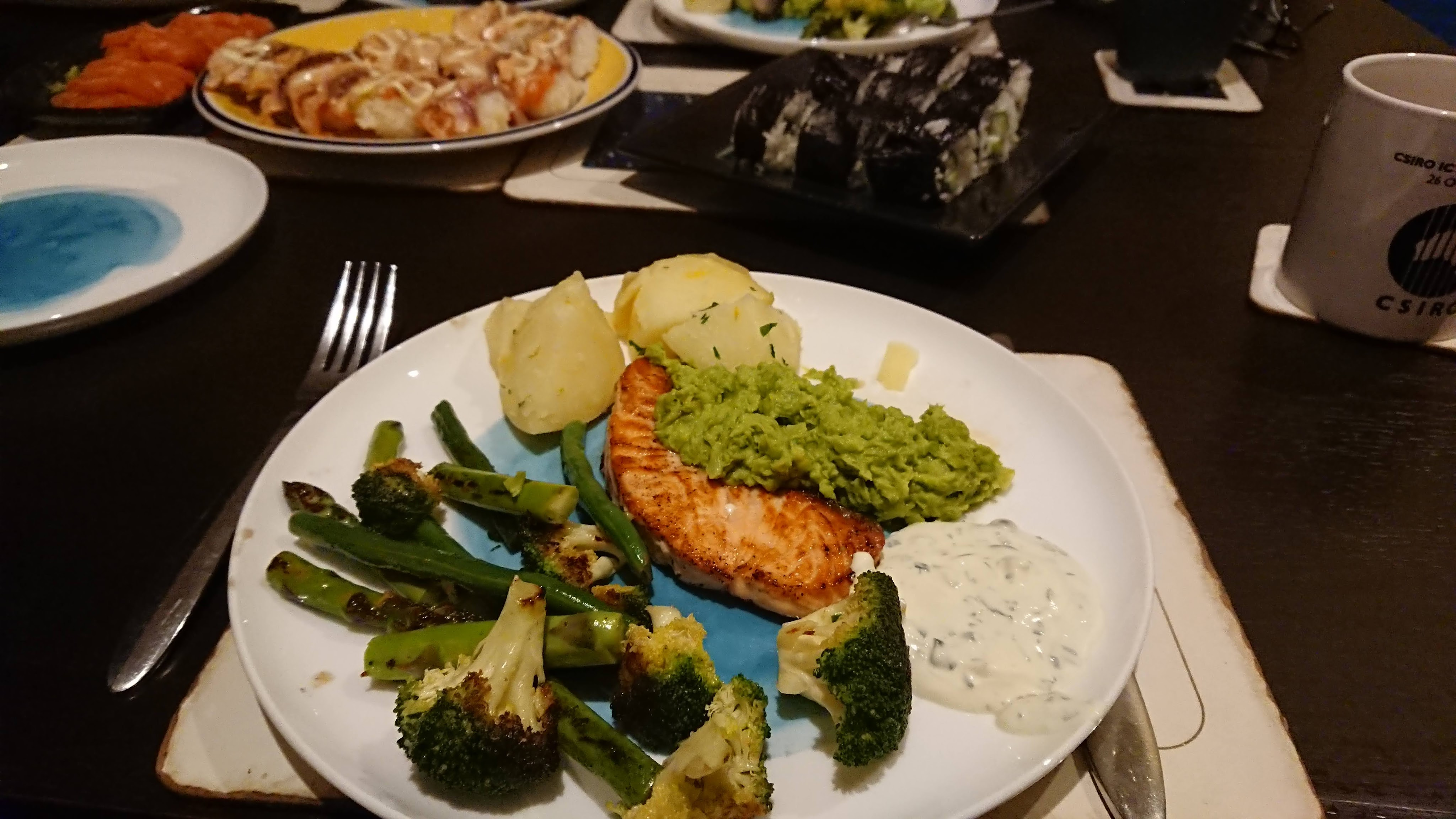 Salmon with pea mash and vegetables.